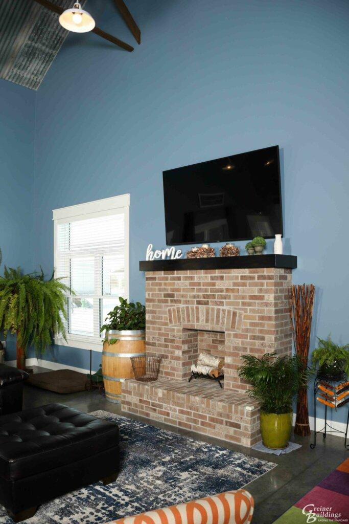 brick fireplace inside new pole barn house