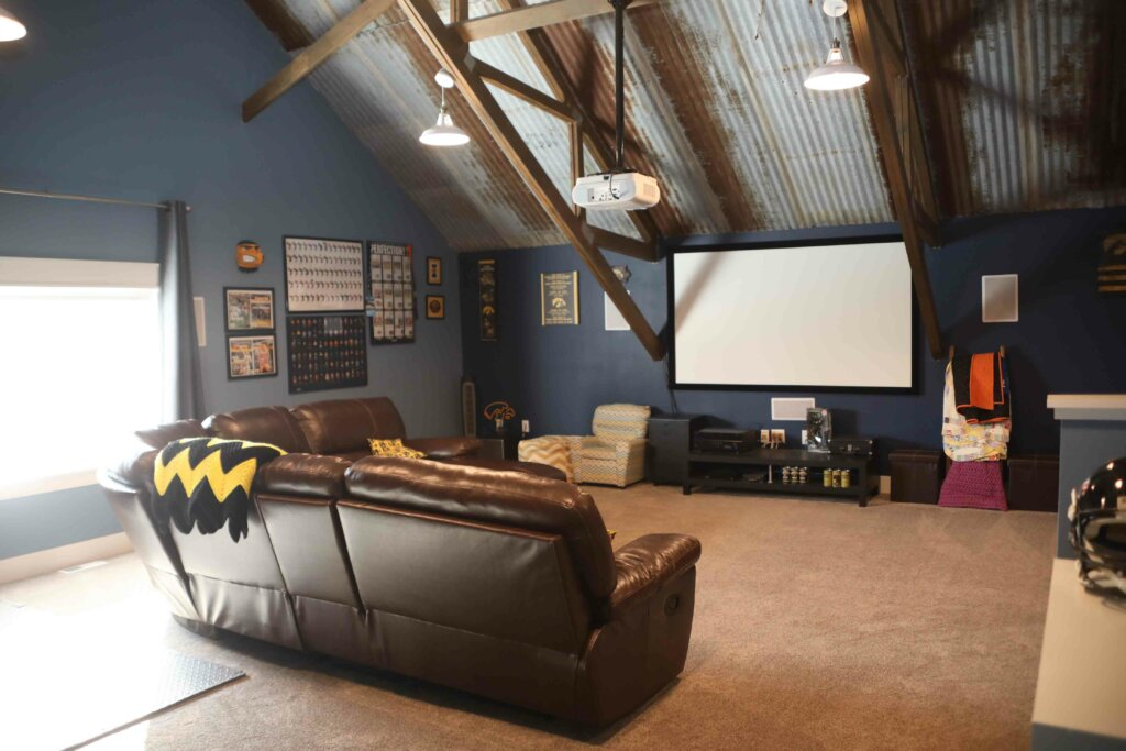 couch and projector inside pole barn house