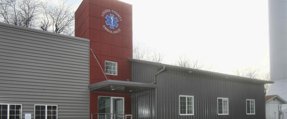 gray custom pole building for county ambulance station