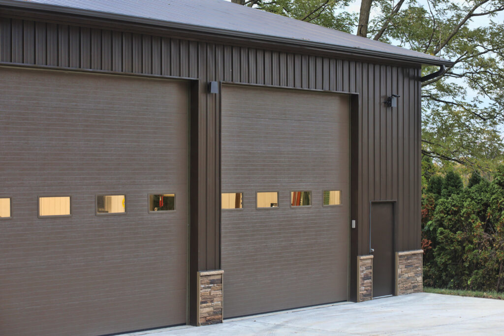 metal ag building with stone wainscoting