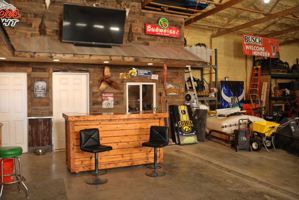bar and flatscreen tv inside custom pole building barn