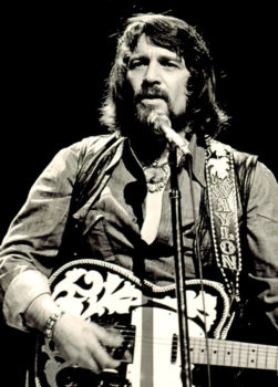 Waylon Jennings in concert, 1976. Photo by Todd Everett.
