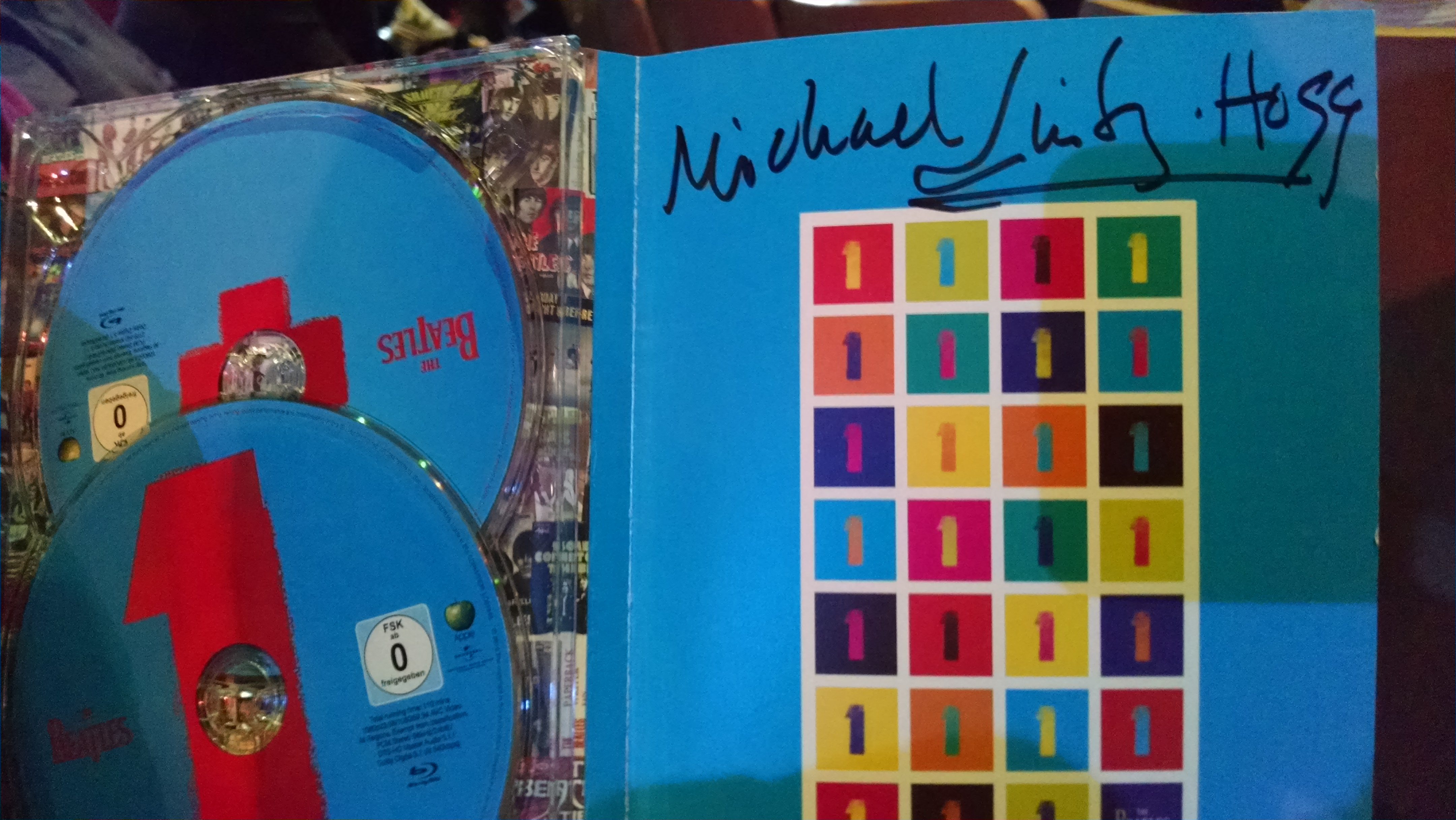 Beatles 1+ signed by Michael Lindsay Hogg
