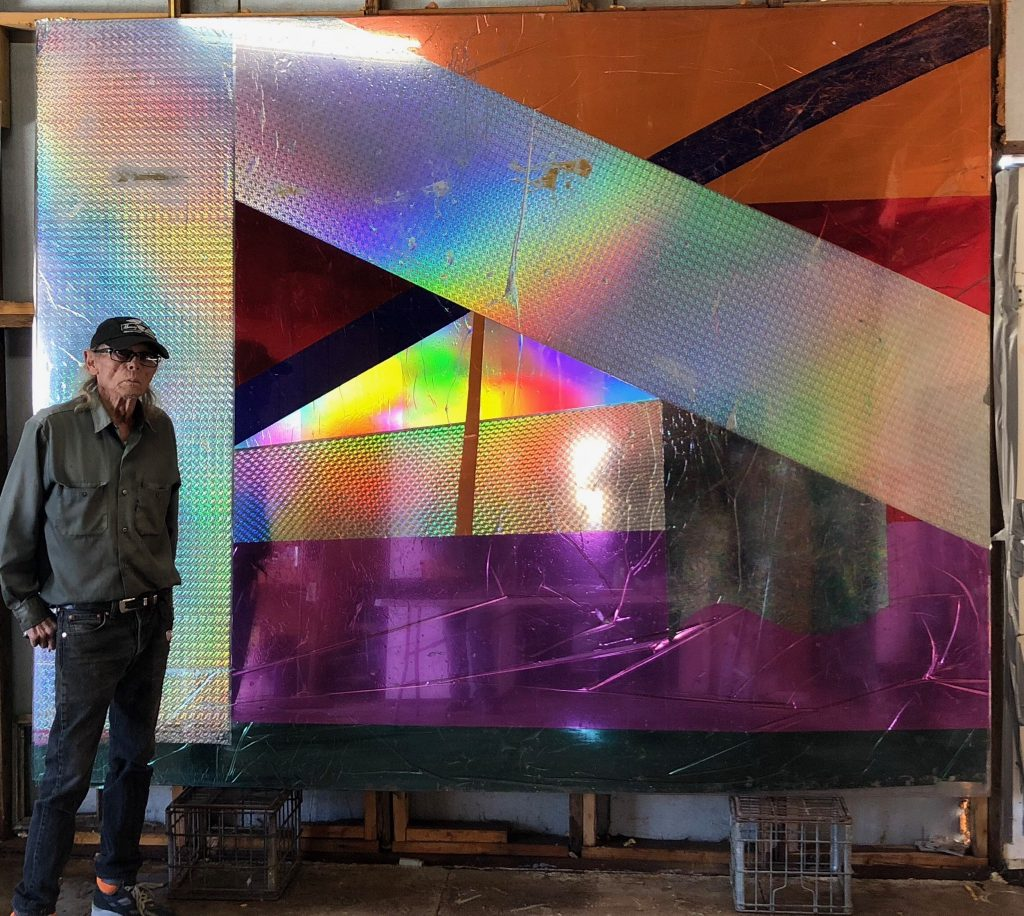 Boyd Elder with untitled large-format piece with holographic foil applied to polycarbonate plastic. Valentine, Texas, Jan. 2018.
