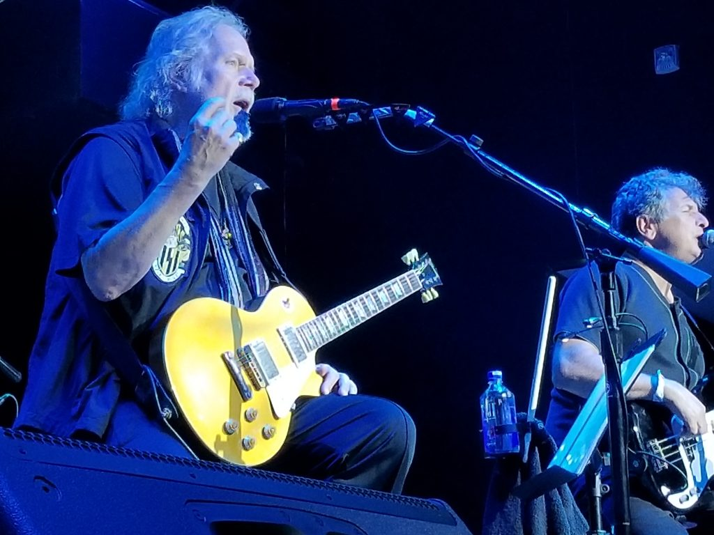Randy Bachman tells the story behind one of his classics onstage at the Canyon Santa Clarita, July 22, 2018. Photo: Stephen K. Peeples.