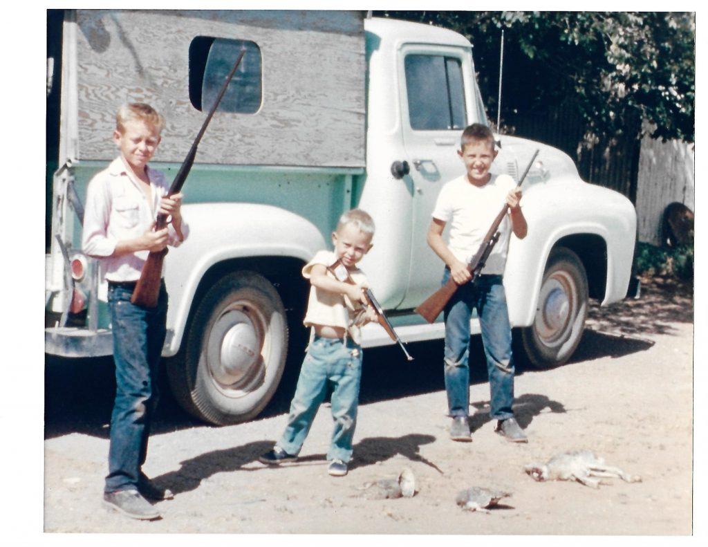 After a rabbit hunt, Boyd, Harold and Mack Elder pose in front of Uncle Buck's pickup, Valentine, summer 1956. Photo: Courtesy Boyd Elder Estate.