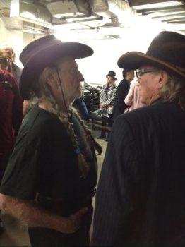 Willie Nelson and Boyd Elder swap tall tales backstage. Photo: Courtesy Boyd Elder Estate.