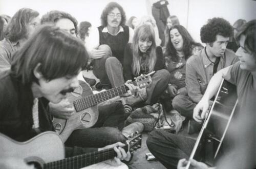 "Jackson Browne (left) leads a singalong at Boyd Elder's ""Chingadero Show,"" Venice, California, April 2, 1972. Photo: Henry Diltz."