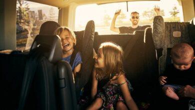 happy family in van leaving for trip