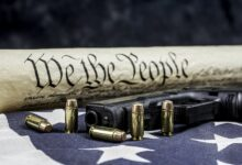 US Constitution and gun with bullets