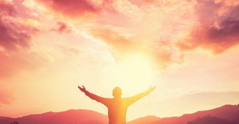Hopeful Sunrise with Man Praising God