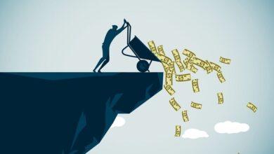 Man dumping money off a cliff