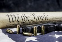 Constitution and gun with bullets defending our freedom