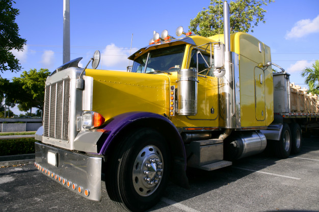 yellow-american-truck-with-stainelss-steel_79295-19580