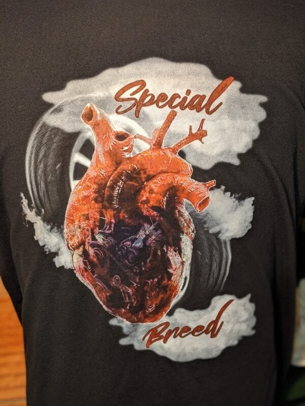 Closeup of Special Breed Heart on black shirt