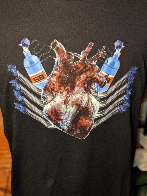 closeup of v8 nitrous heart on black shirt