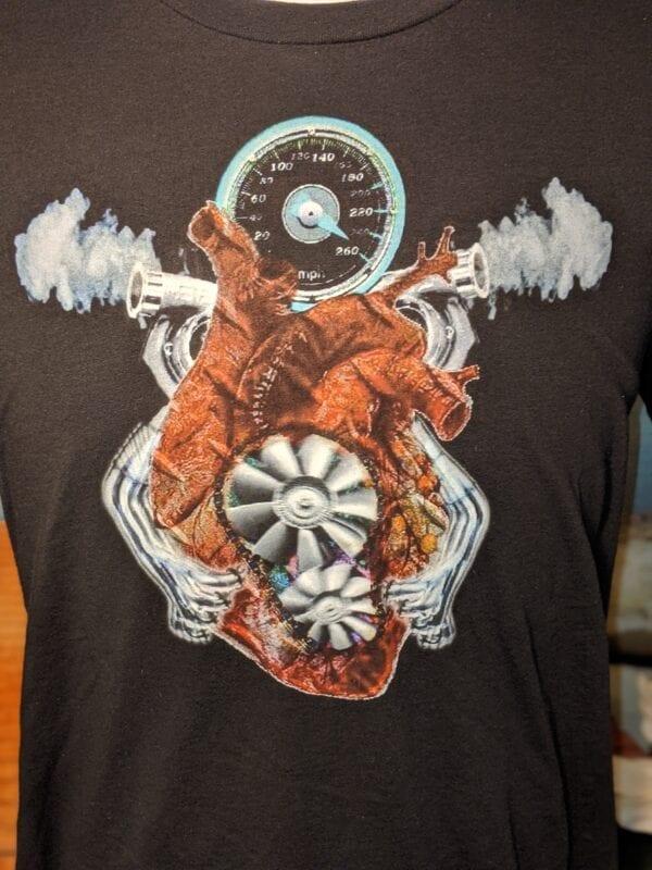 closeup of black shirt with V8 twin turbo heart