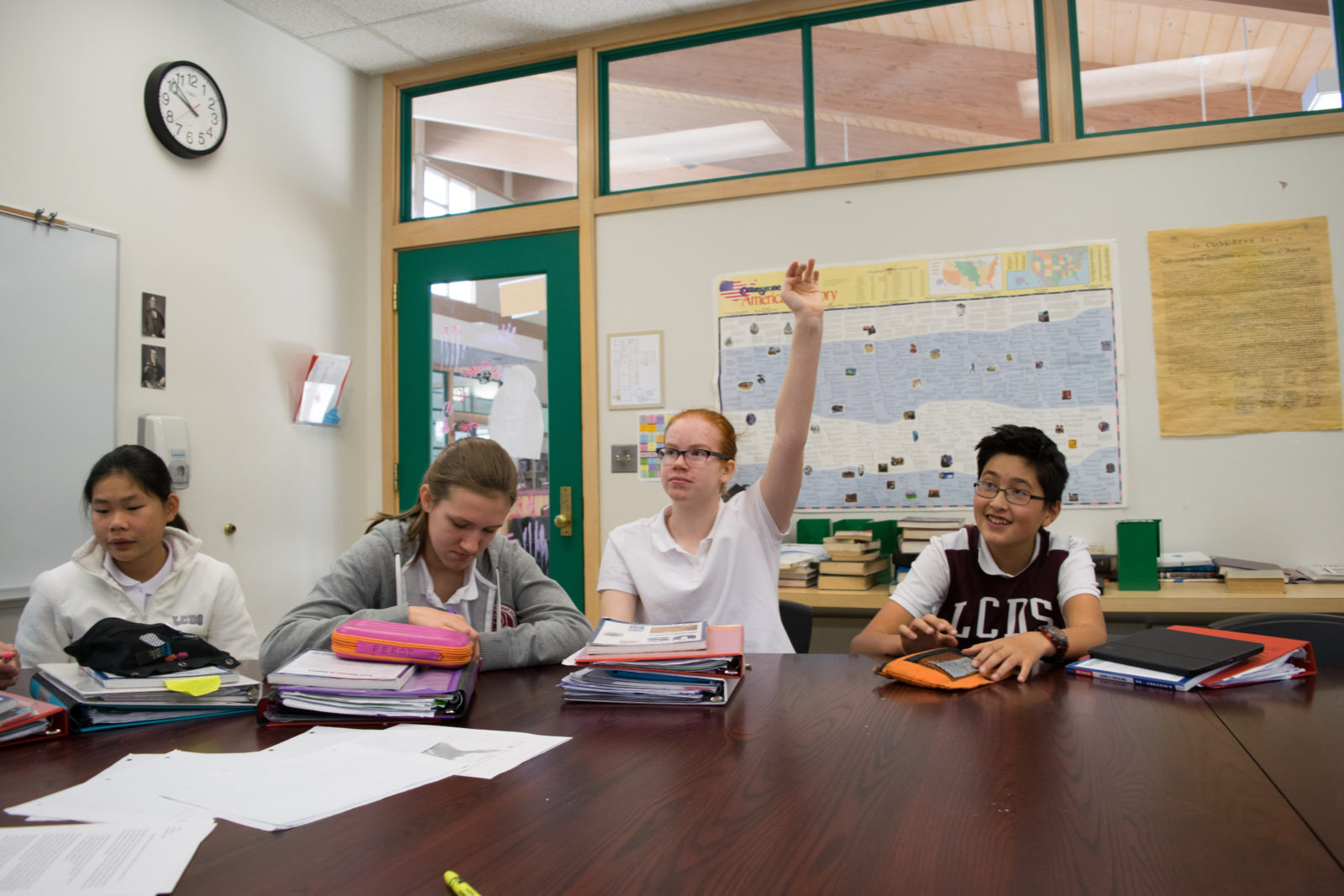 In history class, students are discussing some of the first battles in the Revolutionary War.