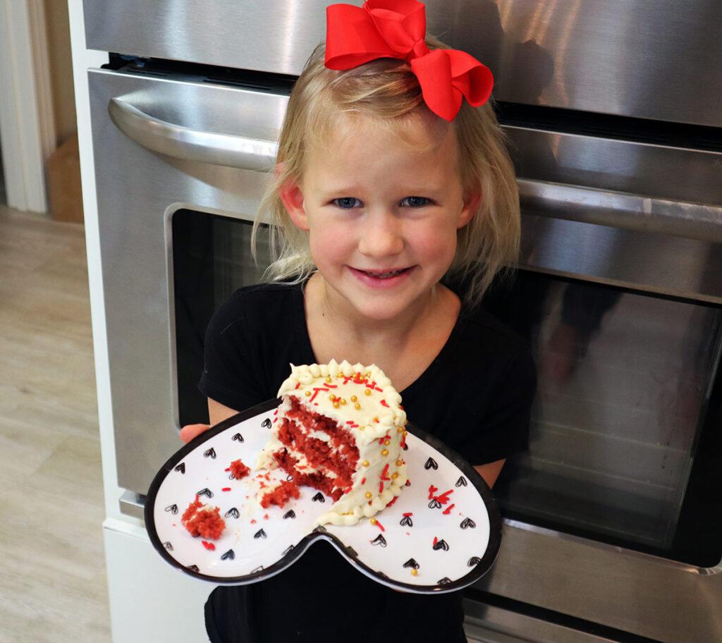 Little girl with red velvet cake