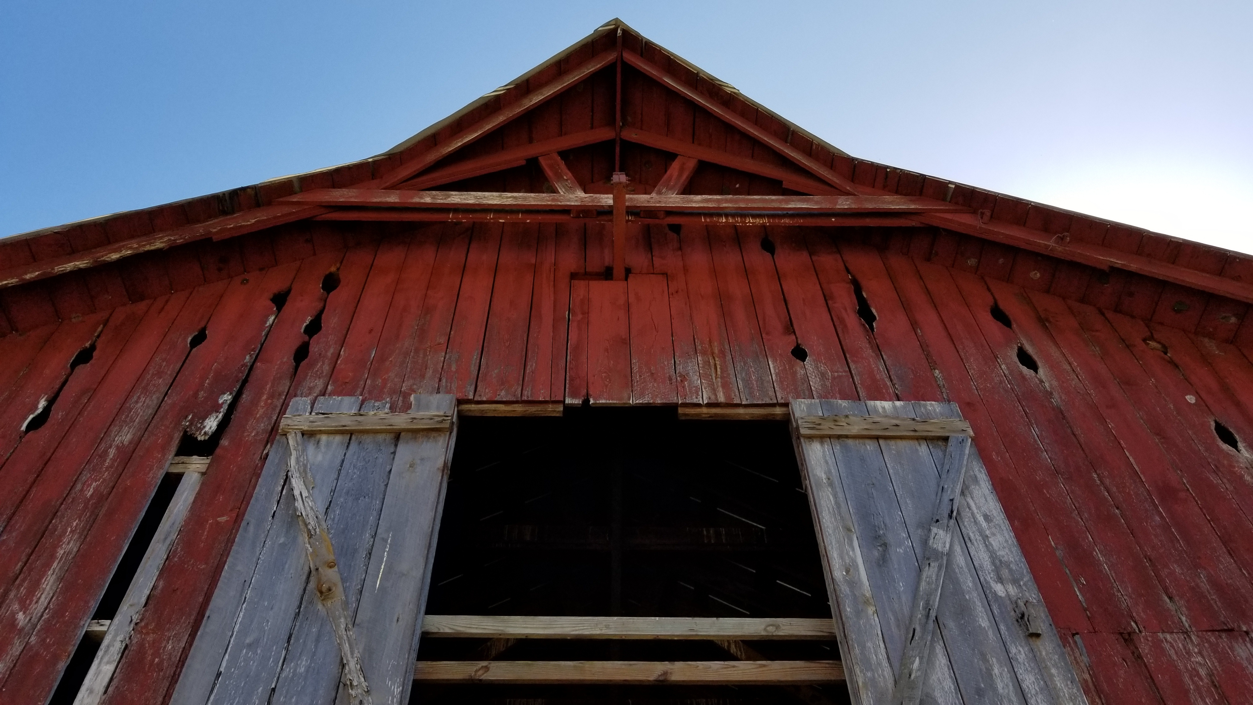 Old red Barn with white doors
