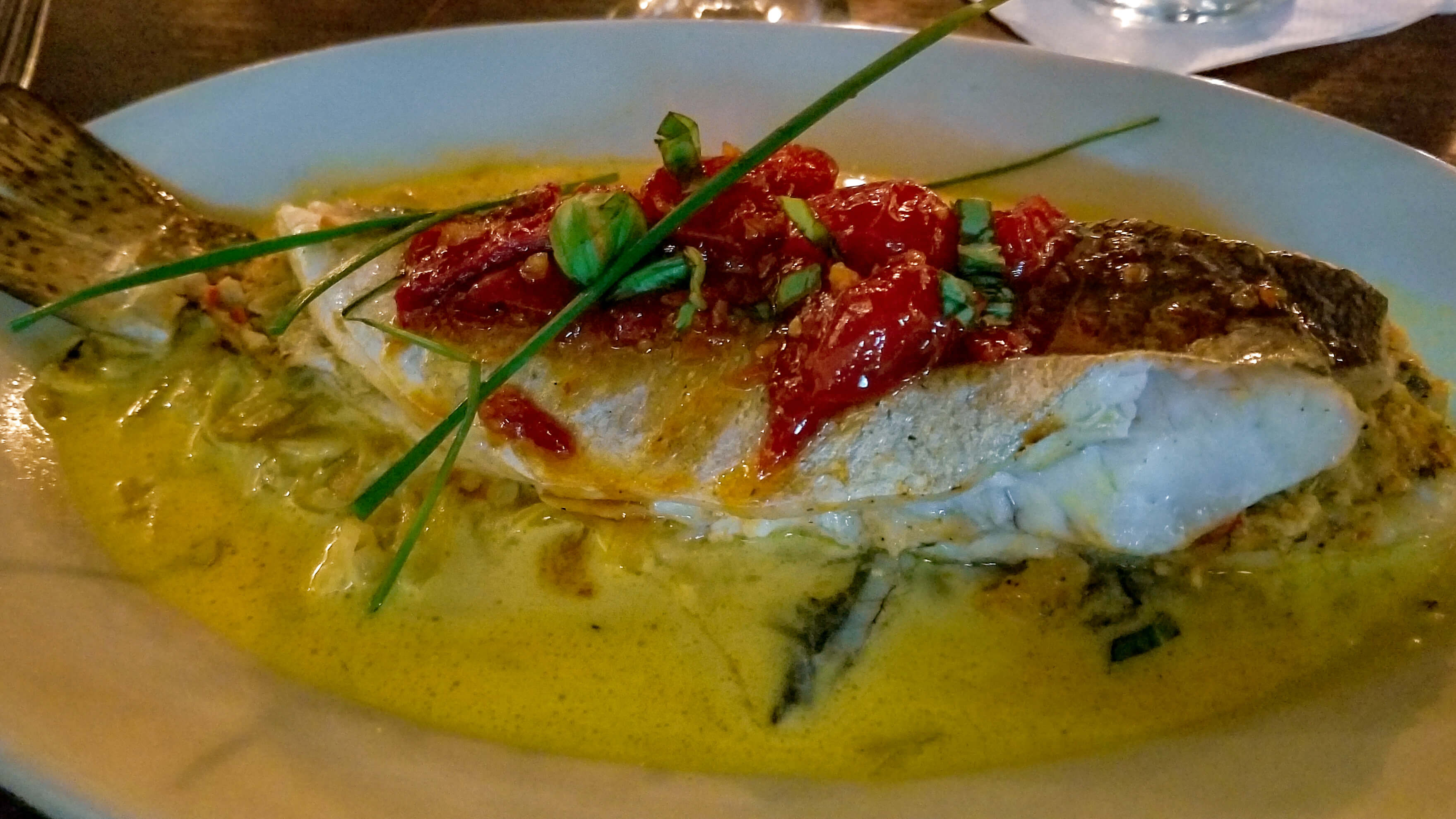 Whole fish in curry sauce at gabrielle's new orleans