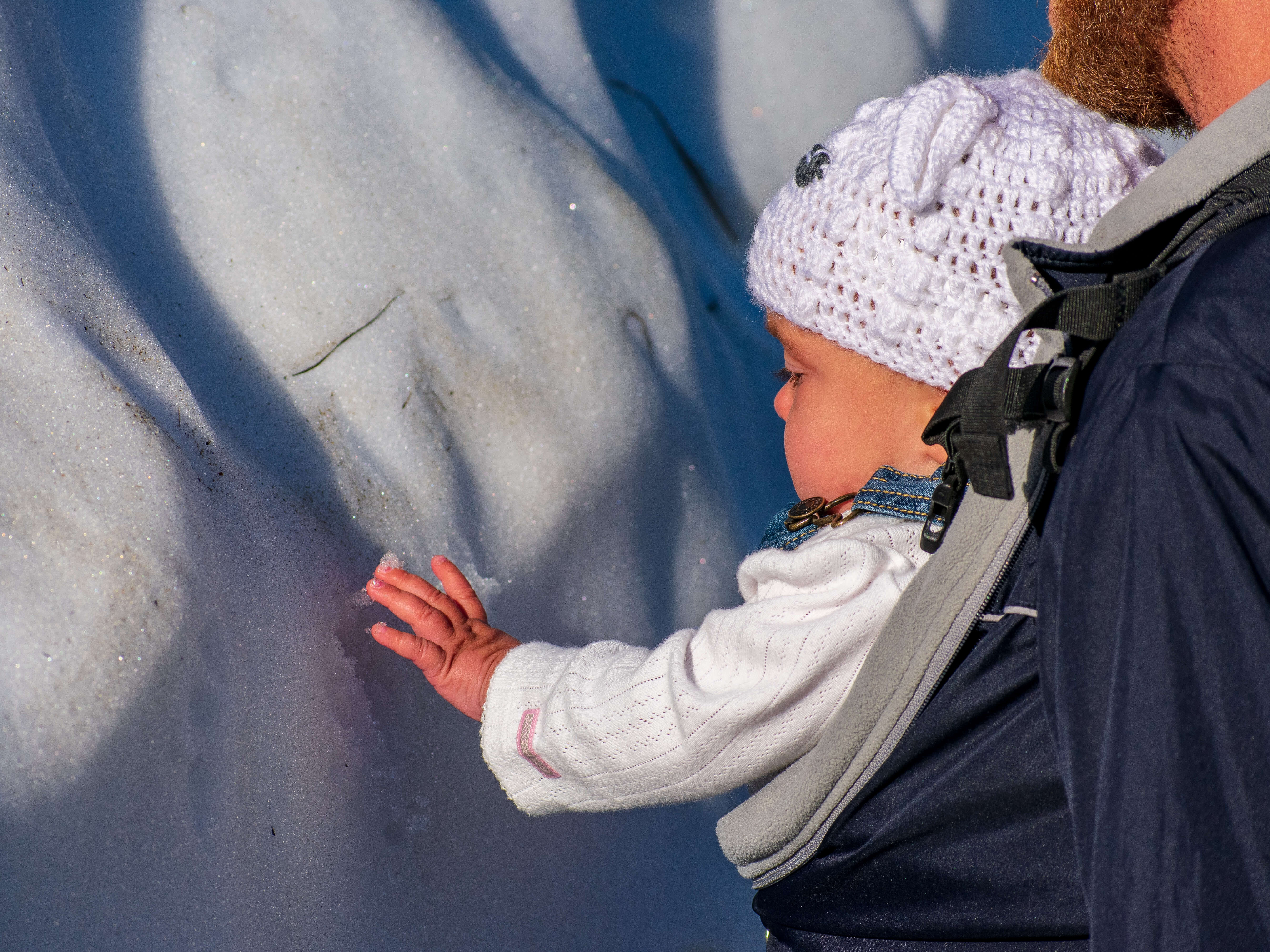 Baby touching snow
