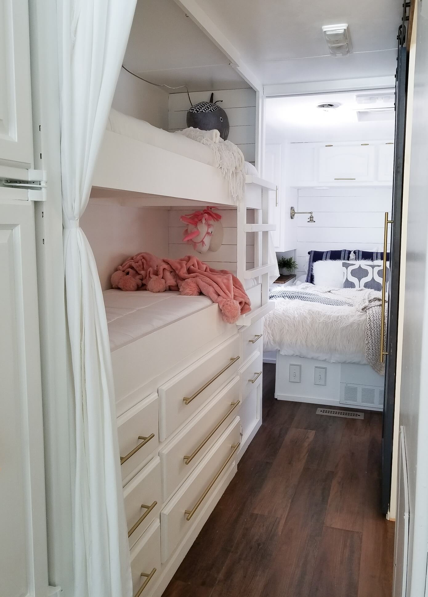 Renovated RV bunks and bedroom of remodeled motorhome