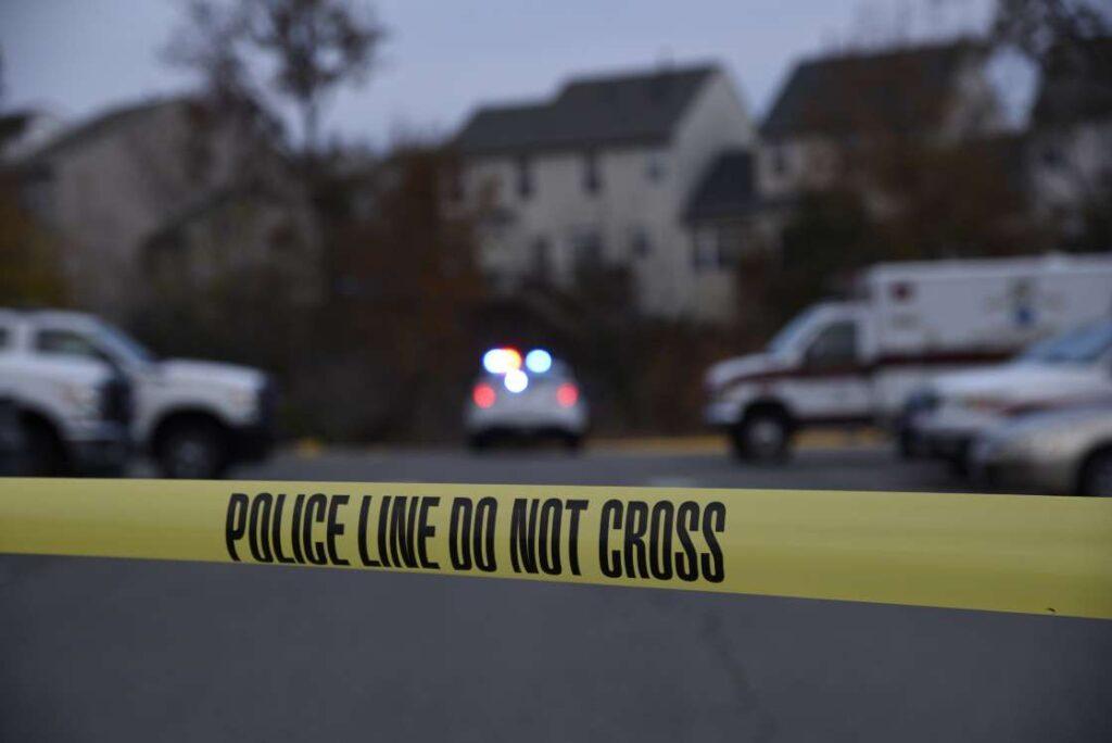 Woman Arrested After Boyfriend's Body Found in Backyard