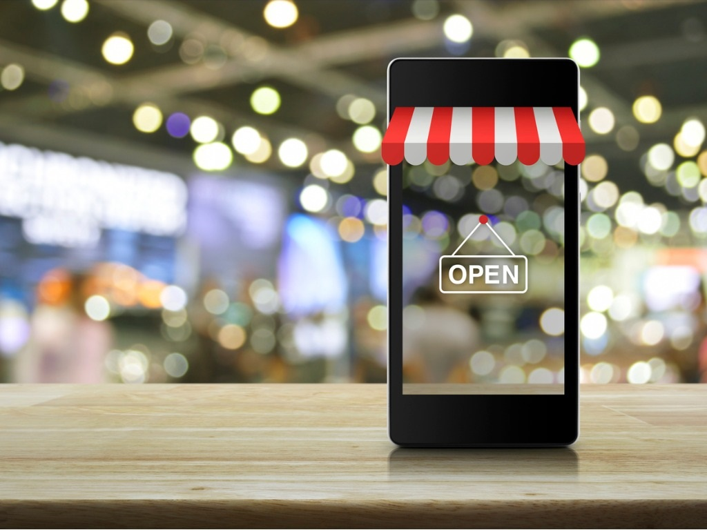 horizontal modern-smart-mobile-phone-with-on-line-shopping-store-graphic-picture-id621822666
