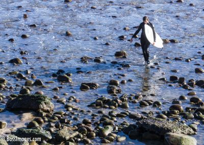 Surfer on stony shore-1