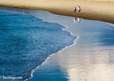 20couple strolls Ventura Harbor beach