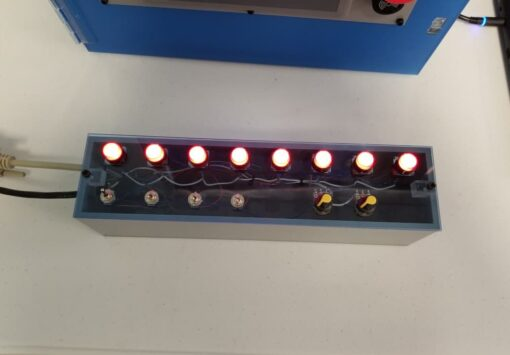 I/O Pushbutton Box overhead view with lighted buttons.