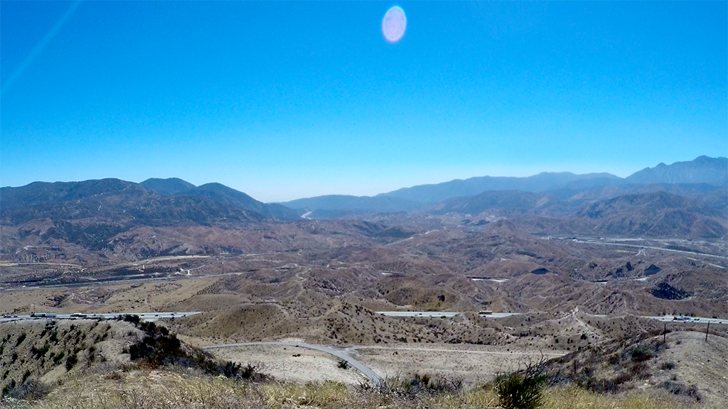 This August 2018 photo shows a steady layer of ground-level ozone creeping up through the Cajon Pass and into the Mojave Desert Air Basin.