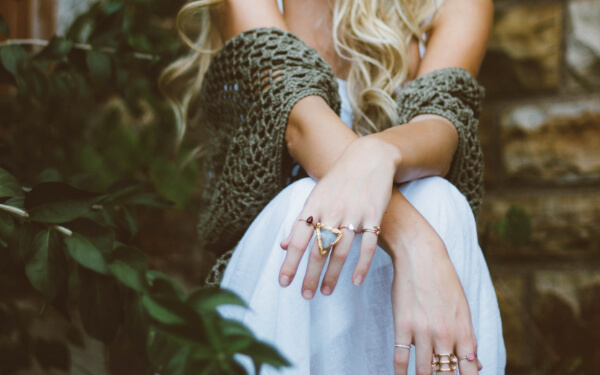 Beautiful Hands of Girl with Rings in Fingers