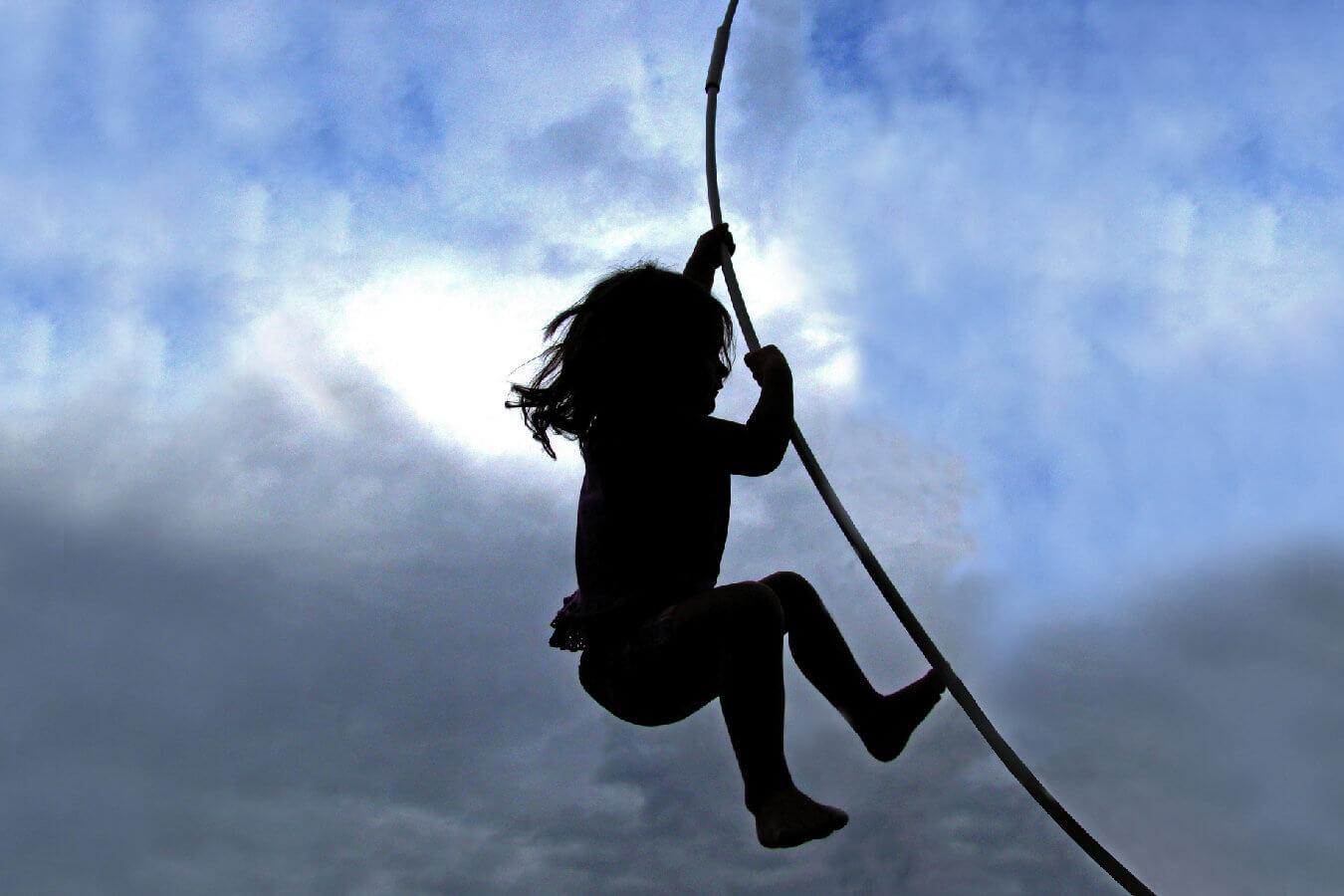 Little Girl Swings on a Rope