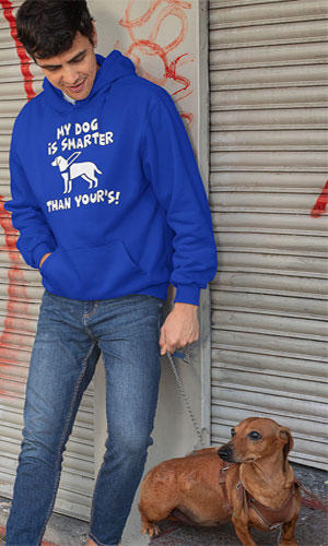 A boy wearing a blue hoodie with my dog is smarter than your dog!