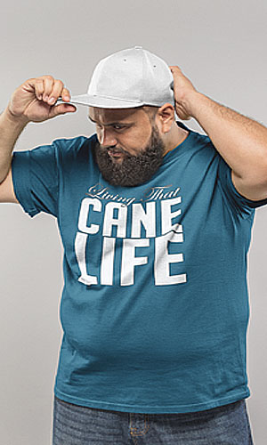 a man in a blue t-shirt with Living That Cane Life