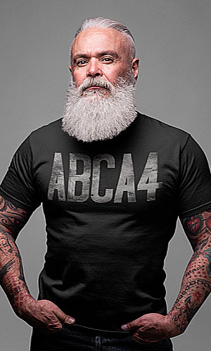 A man with tattoos wearing a black shirt with ABCA4