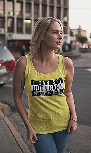 A woman wearing a yellow tank top with I can see But I can't #ItsComplicated