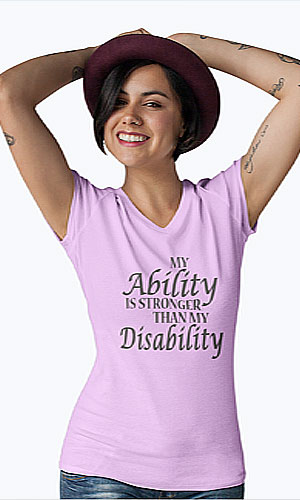 A woman wearing a pink shirt with my ability is not my disability