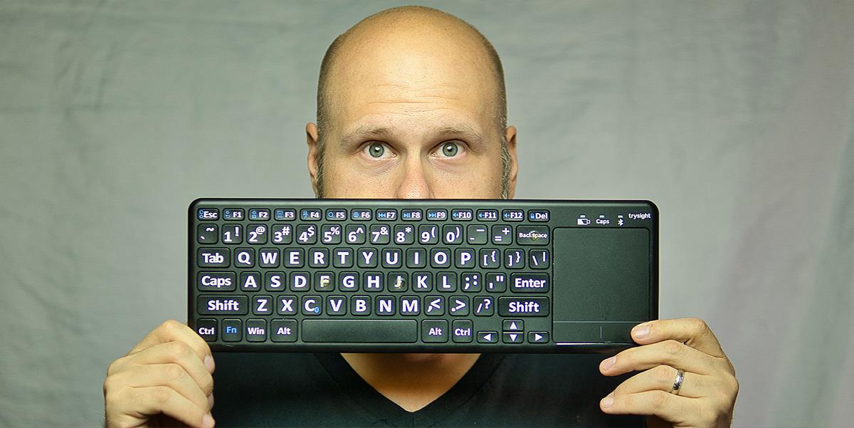Sam holding up a computer keyboard
