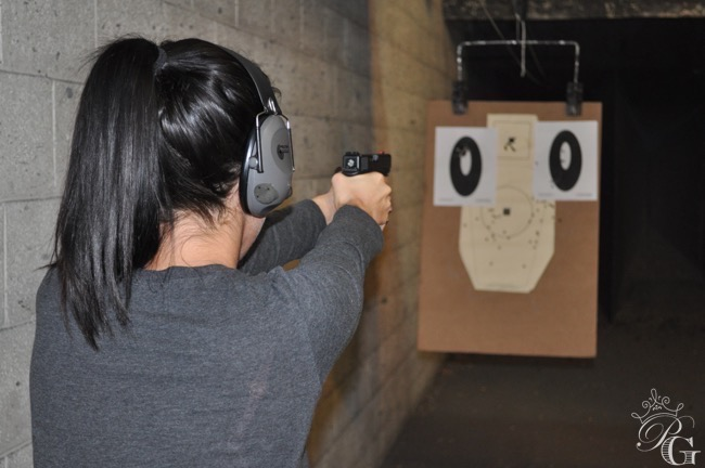 firearms training female shooting indoors