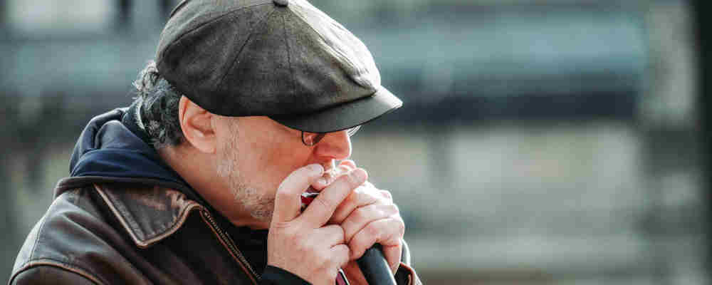 Man playing harmonica