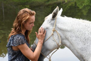 Production Still of Actress Shannon Spangler and the horse, Zack on set