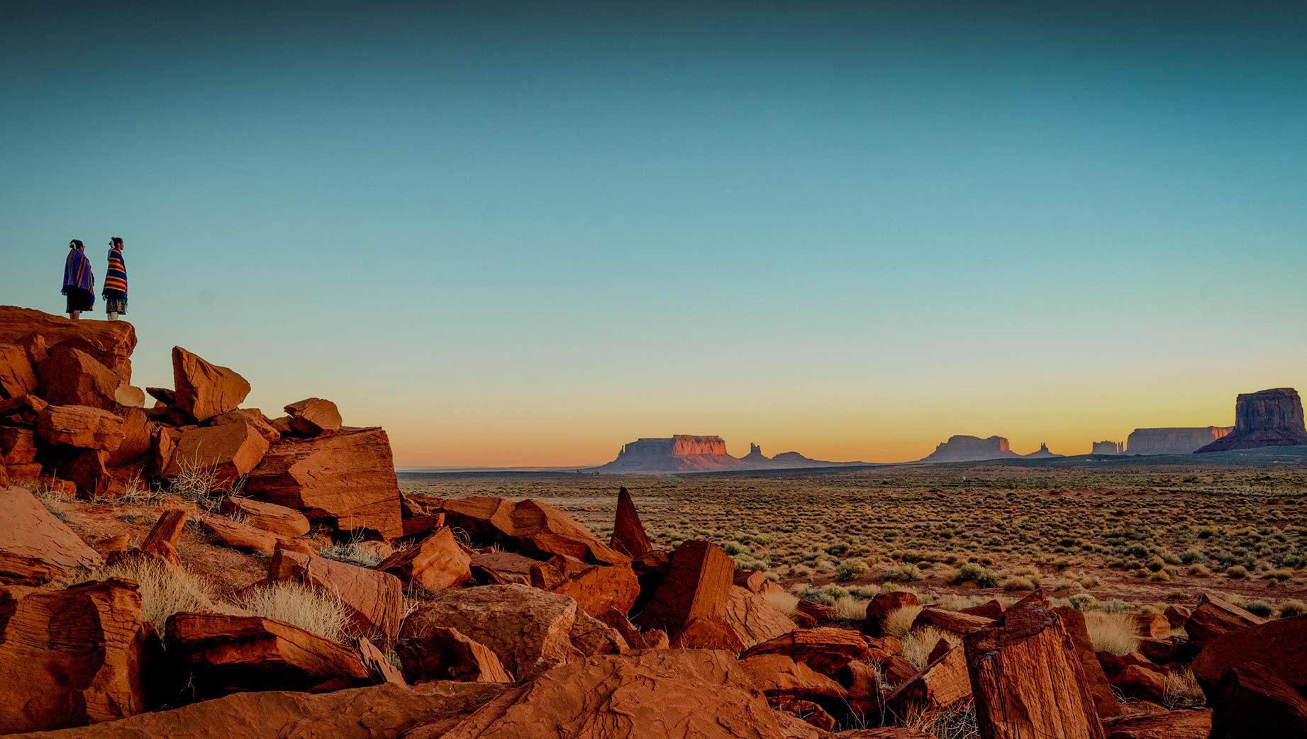 two woman overlooking monument valley