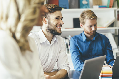 Smiling man in computer setting