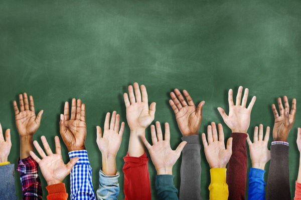 Group of children's hands raised