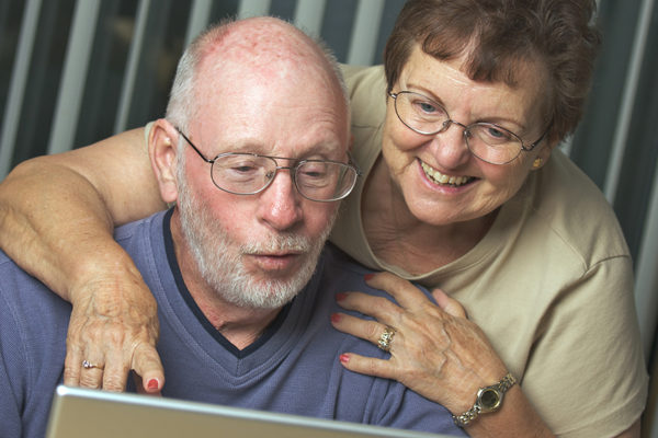 Baby Boomers Working on a Laptop Computer