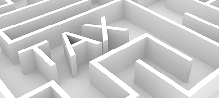 A white maze with TAX spelled out as part of the maze barriers. Scott Nissen can help you navigate your taxes.