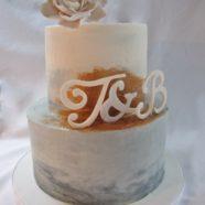 Grey white and copper wedding cake